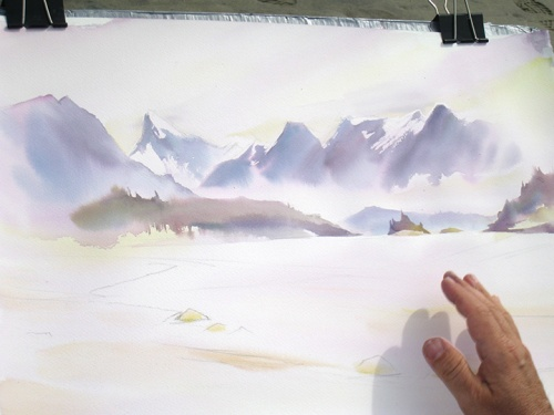 """Working into the underpainting and learning to control the hard and soft edges of the mountain and cloud shapes."""